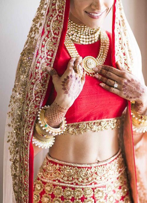 Melanie Kannokada Chandra Manish Malhotra red lehenga