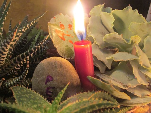 This is photo is of the peace candle in my Advent garden. The full word peace is obscured, the leaf behind is splattered with red wax - a little like blood. I could not help but think of that this ...