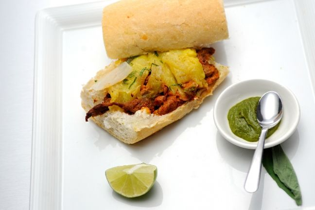 Carlos Gaytan added some sweet fruity deliciousness to his Quickfire challenge with his al pastor po'boy with guajillo chilies, pineapple, onions and roasted garlic. Get the recipe here!