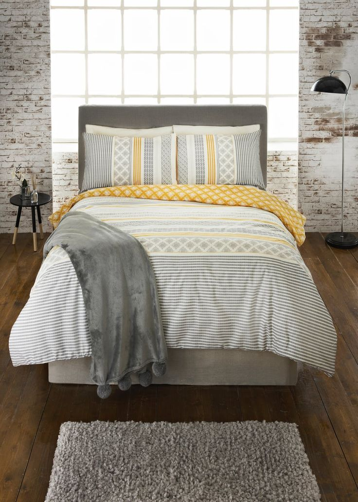 This aztec style printed duvet cover in mustard grey and soft cream is the perfect way to freshen up your bedroom. Made in 100% soft cotton with a 200 thread...