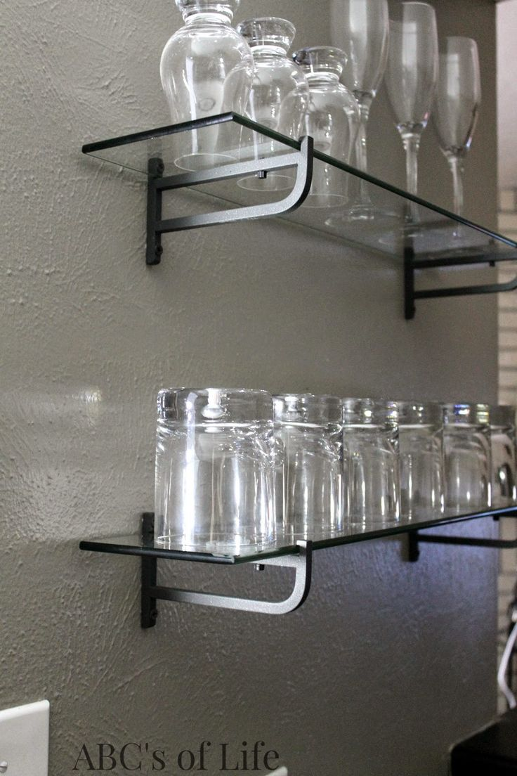 Masculine wet bar reveal with glass shelves from Ikea perfect to display your collection of stemware and a chalkboard wall!