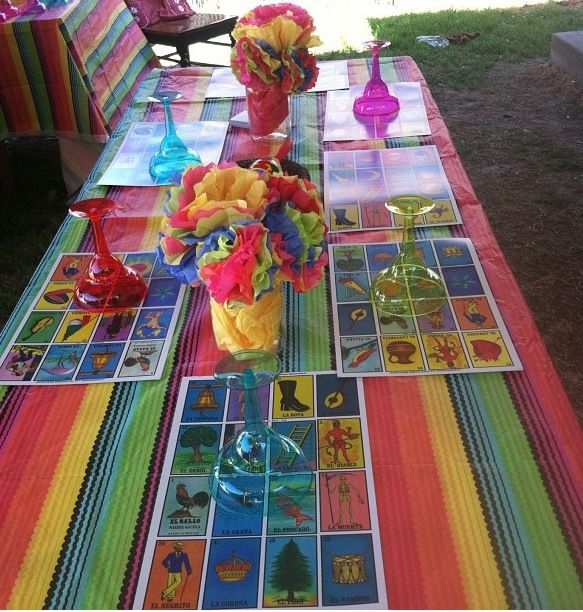 Mexican fiesta theme! Table ideas! I did this for my daughters Graduation party. I used large loteria cards as placemats, stuffed mason jars with bright tissue and made flowers out of tissue..