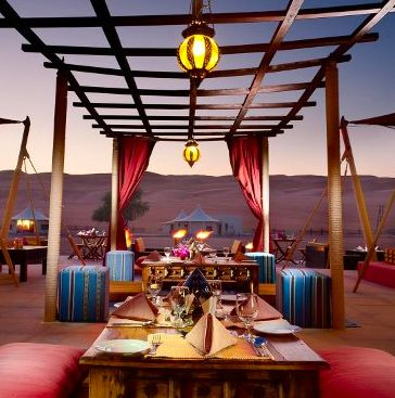 outdoor dining at sunset -- Desert Nights Camp, Oman #glamping in the Middle Eastern deserts