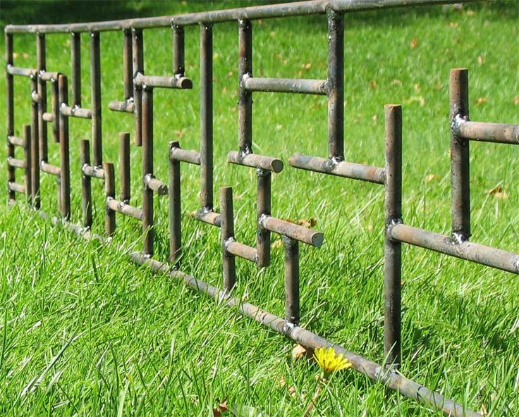 A Beautiful Metal Fence In Maze Form.