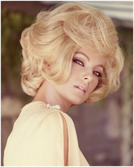 Virna Lisi - Italian actress, wearing a yellow top with slashed sleeves, with a blonde bouffant hairstyle, circa 1960