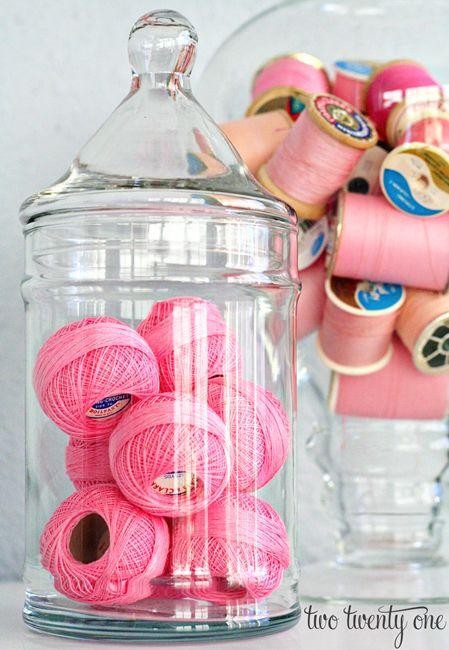 Use glass jars with vintage thread spools