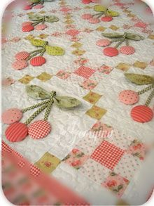 I love this quilt, (I would make a table runner for my Cherry Kitchen) especially the 3D effect with the leaves, stems and cherries.