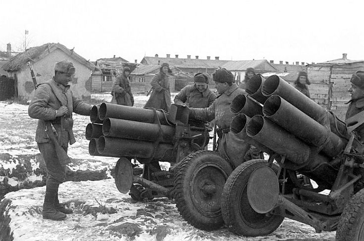 Stalingrad, January 1943: Smiling Russians examine German multiple rocket launchers. The mighty 6th Army is no more.