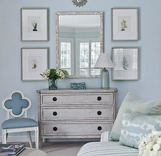 wall arrangement with mirror and chest