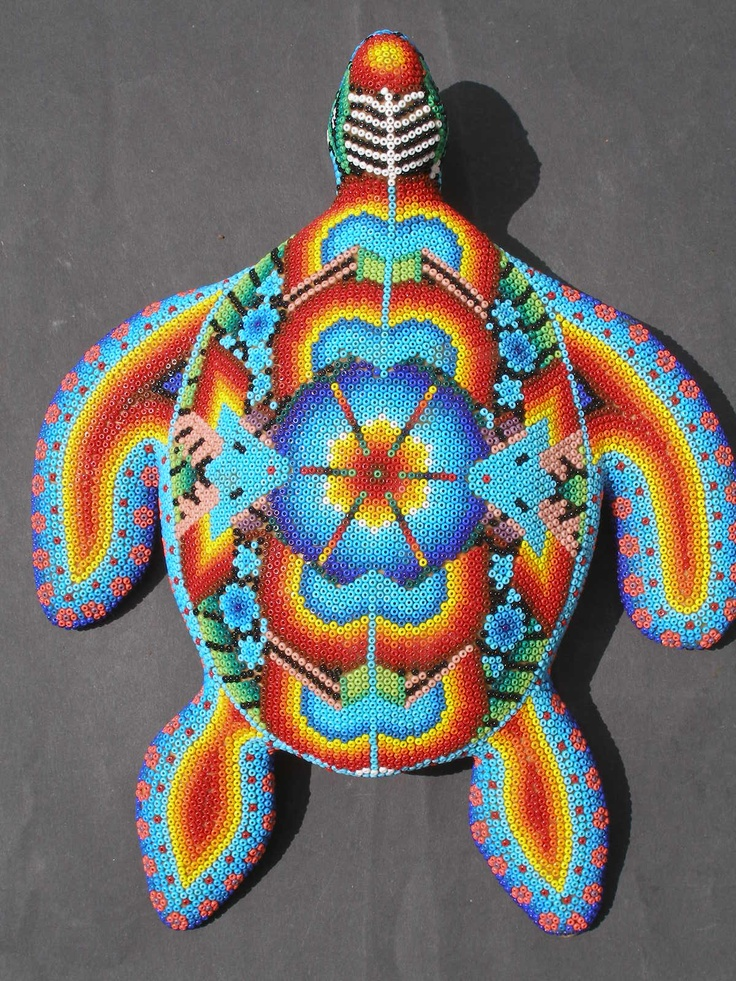 Huichols are an indigenous group from central western Mexico. They are masters of an unusual and fascinating craft which involves creating very graphic beaded surfaces on bees wax covered animal sculptures.
