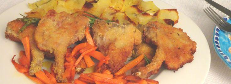Costolette di agnello fritte con carote e patate al velo
