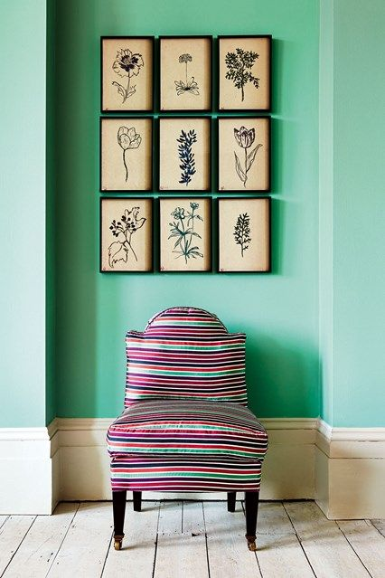 Green Farrow & Ball walls & flower drawings by Lucy Auge behind a striped chair. Modern Hallway furniture & design ideas on House & Garden.