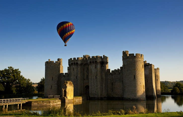 A hot air balloon rising above the battlements of Bodiam Castle, East Sussex.