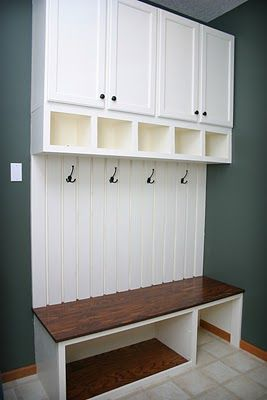Utility room- shoe and coat storage - could add another rack under bench for more shoes. Shelf nooks above good for gloves/scarfs etc.