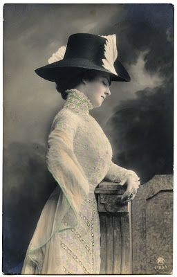 Woman in lace frock and feathered hat, circa 1908