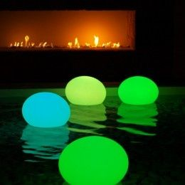 """For a night time party! Glow sticks in balloons in swimming pool – place as """"orb"""" around the yard"""