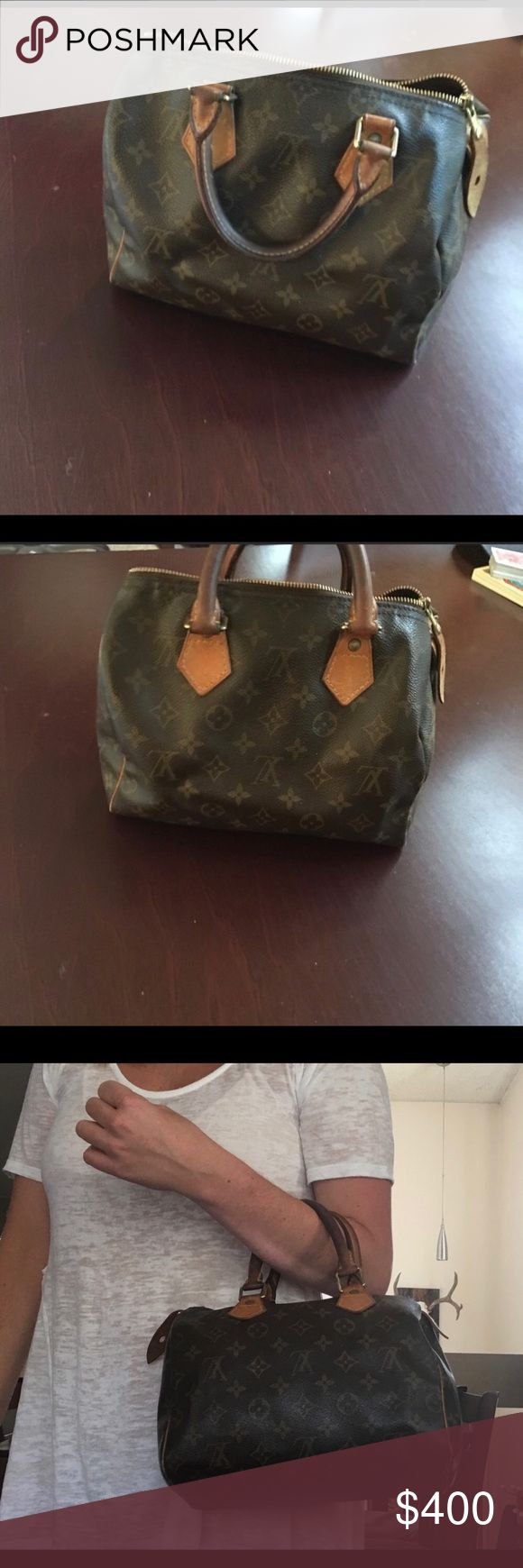 WANT TO SELL ASAP!! Louis Vuitton Speedy 25 tote This second hand REAL Louis Vuitton monogrammed canvas bag. An icon of our times, this city bag is ideal for the fast pace of modern life. Wherever you need to go, the Speedy 25 makes zipping around town a pleasure. Louis Vuitton Bags Totes