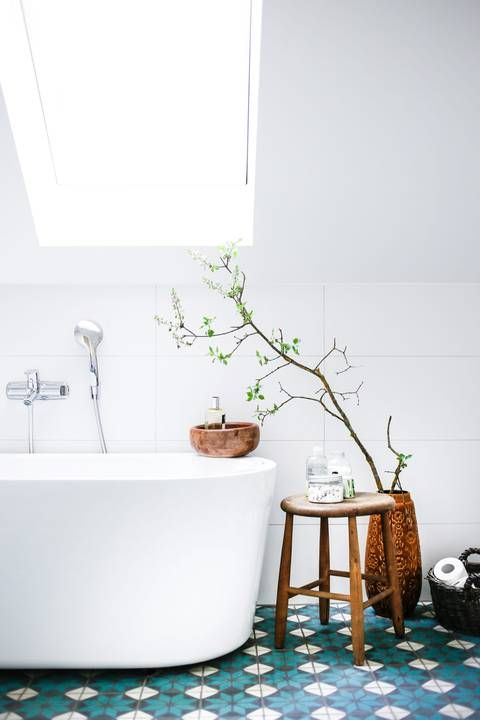 all white with a kick of color in the tile
