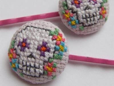 Cross-stitch sugar skull hair clips.