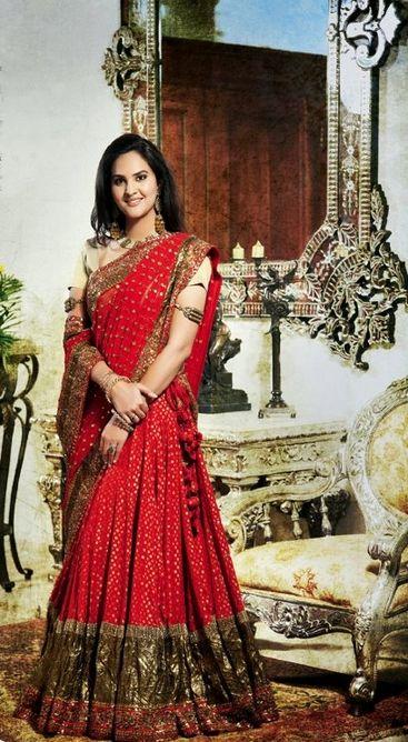 Princess Nivritti wears a dark red Sabyasachi lengha