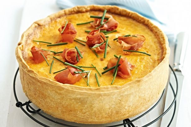 Made more glamorous with the addition of gruyere and prosciutto, this quiche is smart enough to be presented to guests and satisfying enough to be served for a family meal.