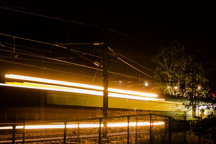 L1M2AS3 - Blurred Motion - Canon 550D, TV mode, no flash, tripod, f4.5, 3.2sec, iso800(auto), 79mm, awb. Didn't realise how tricky it was to catch light trails of a train at night. The auto focus mode let me down on so many occasions and became quite frustrating. Perseverance paid off.