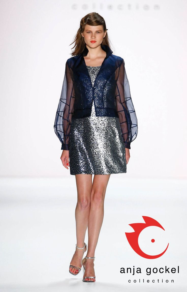 "An absolutely ""en vogue"" glamour outfit. Gradient sequin sheath dress in mini length combined with a futuristic see-through jacket made out of dark blue organza with loving attention to details in the seams."
