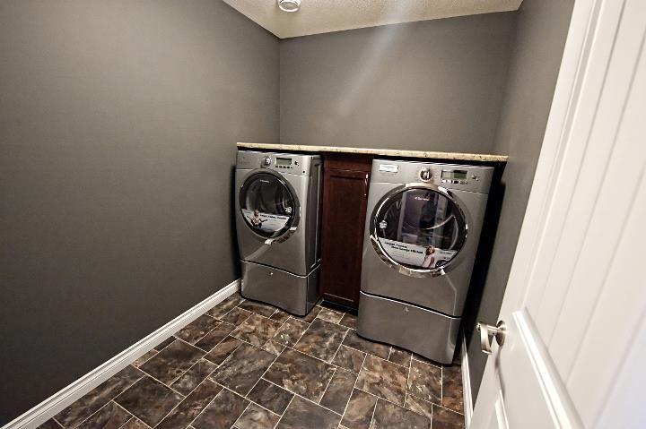 Washer dryer with shelf and dividing cabinet.  https://www.facebook.com/media/set/?set=a.157700360978936.39655.135706893178283&type=3