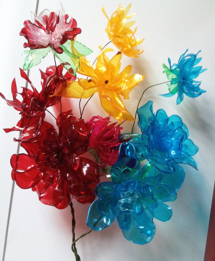 Best 25 plastic bottle flowers ideas on pinterest for How to make bottle cap flowers