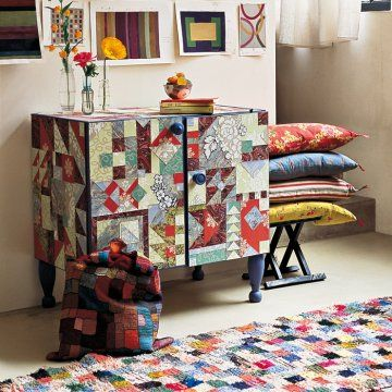 Furniture covered in wallpaper that has been cut into quilt pieces. Love.