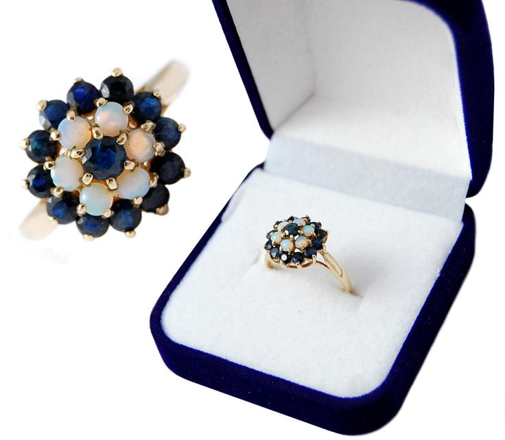 Lovely sapphire and opal dress ring is featuring 12 dark blue sapphire and 6 opal.  This 9ct gold ring was made in Birmingham  The maker's mark 'L.W'
