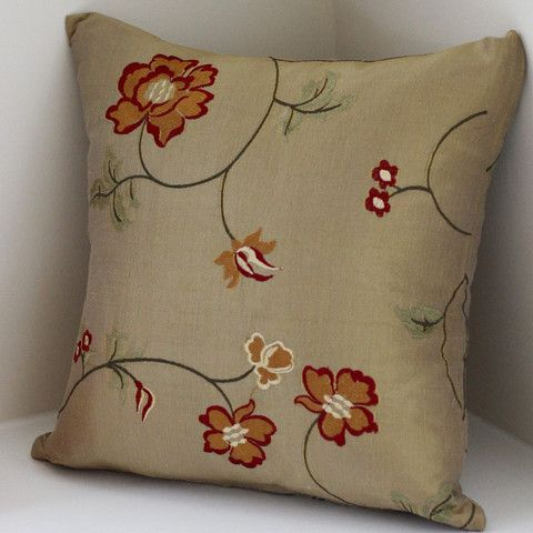 """A slightly iridescent gold silk, with green undertones, accented with an embroidered floral pattern. - 100% silk - Available in 12"""" square size - Pillow inserts not included - Dry clean only - Zipper"""