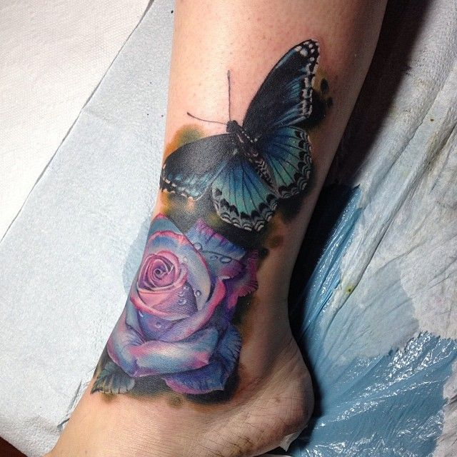 Beautiful color rose--purple-y blue with a gorgeous butterfly By @damianrobertson