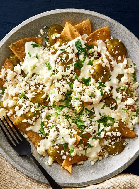 This unique Chilaquiles with Salsa Verde recipe is home-cooking with heart. Crisp tortillas are blanketed in zesty tomatillo salsa verde, Queso Fresco cheese, and delicious sour cream for a delightful treat that is great anytime. #LoveMyQueso