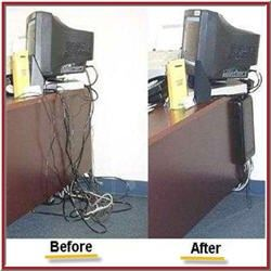 Cableorganizer behind desk organizes tangled wires of - How to organize cables on desk ...