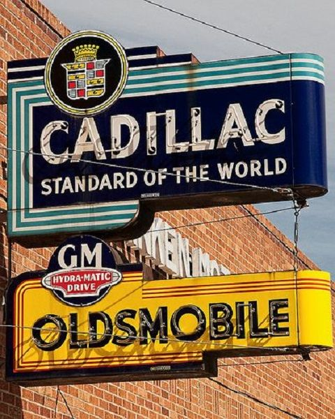 Cadillac And Oldsmobile Signs On A GM Dealership During