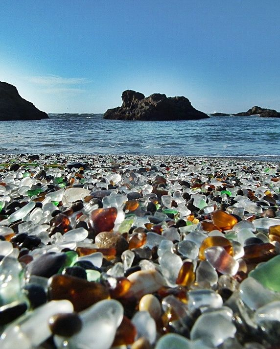 Glass Beach, California. Made from glass that has been disposed, then transformed.