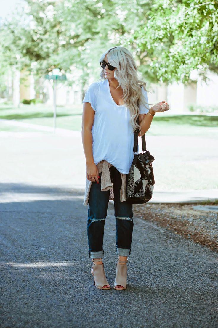 oversized white tee [messy tuck], tan sweater wrapped around the waist, dark wash ripped boyfriend jeans, tan peep toe booties.
