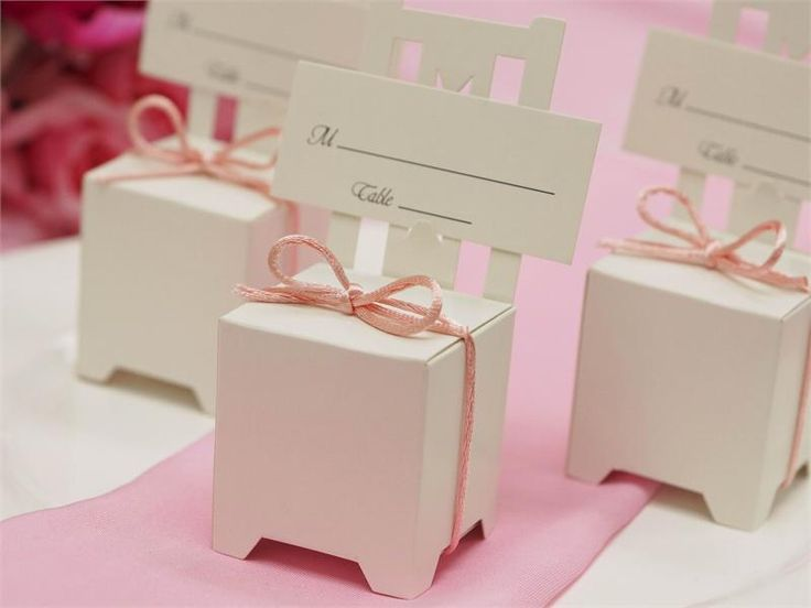These Chair Favor Box Card Holders are just a few of our favorite things to decorate with! What a fun way to tell the guests at your #HolidayWedding where they'll be sitting for the reception!
