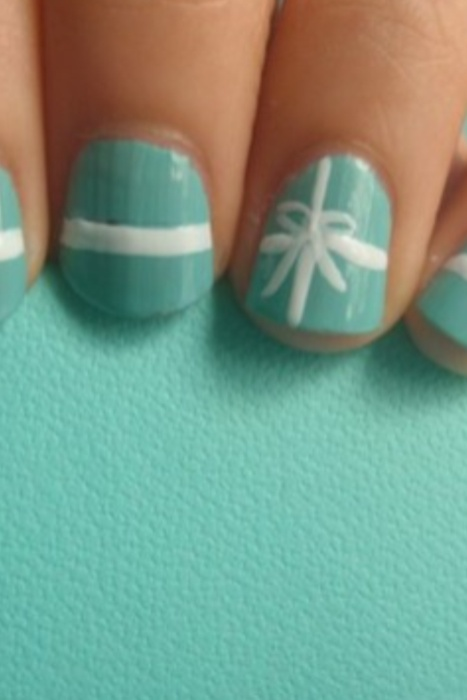 "I came up with the idea to do a ""Tiffany's"" themed nails. And finally found a picture after searching :) I'll definitely be doing these after the holidays!"