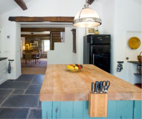 So many people have either granite or tile countertops in their place, opting for butcher's block is like veering left while everyone else goes right. It's a cinch to care for, and blends so perfectly with stainless steel appliances and modern fixtures.    - ELLEDecor.com
