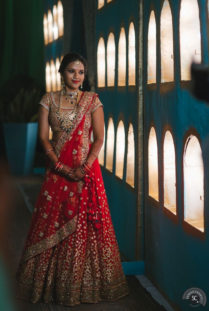 I don't like the hints of red in the blouse or the way the dupatta is draped but love the lehenga! Indian Wedding Website : WedMeGood | Indian Wedding Ideas & Vendors Online | Bridal Lehenga Photos