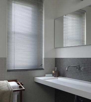 Small bathroom with Luxaflex Venetian blinds.