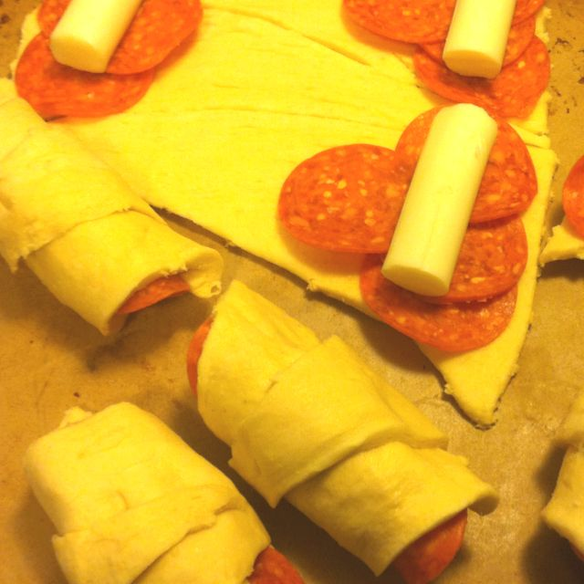 Pepperoni rolls.. Crescent rolls + pepperoni + cheese sticks , would make a fun lunch with the kids, they would enjoy helping