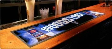 Bar and counter mats are an eye-catching way to promote your brand right where the customer is making a purchase decision! Plus, they provide a helpful anti-slip surface and help to keep the bar area or your counter clean and dry.