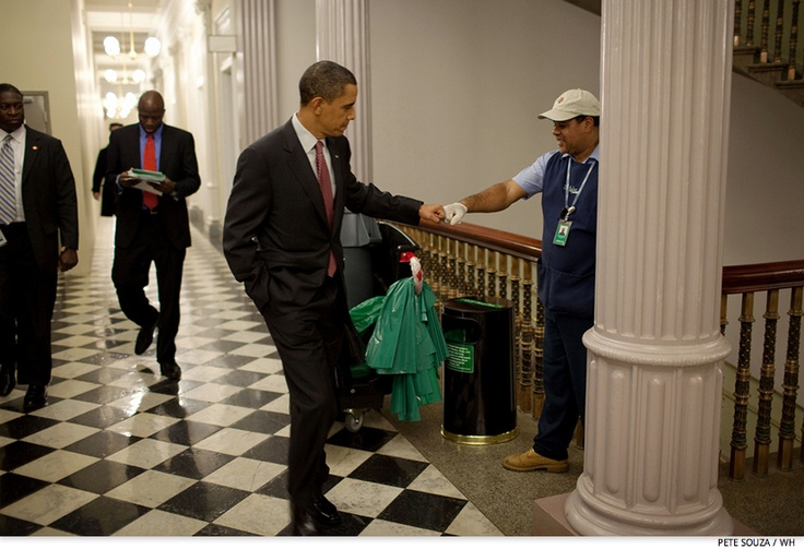 Obama fist-bumps custodian Lawrence Lipscomb in the Eisenhower Executive Office Building following the opening session of the White House Forum on Jobs and Economic Growth, Dec. 3, 2009.