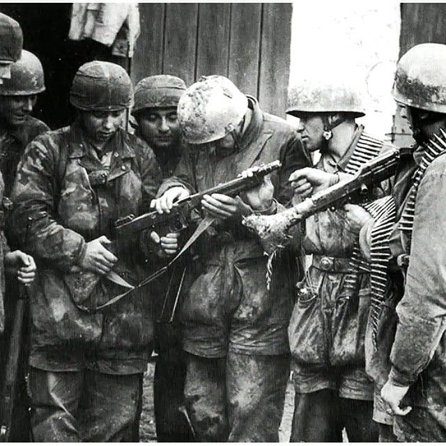 What is this sorcery?  Some german paratroopers look at a Thompson SMG from a captured American soldier , 1944  Go give @spencer561 a follow for my last photo contest , he posts great photos  Partners : @warhistory