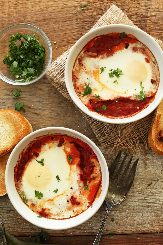Simple baked eggs with a 6-ingredient homemade tomato sauce and customizable toppings. Keep it dairy free by omitting cheese, and gluten free by using GF bread! Hearty, healthy breakfast at its finest.
