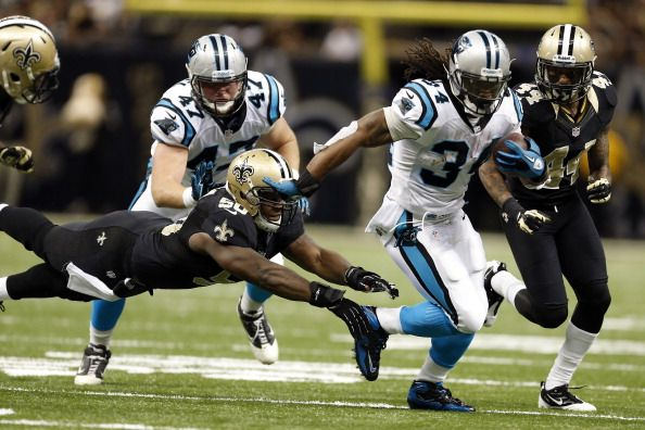 Sunday, December 22, 2013   1 p.m.   Saints @ Panthers   NEW ORLEANS, LA - DECEMBER 30: DeAngelo Williams #34 of the Carolina Panthers avoids the tackle of Curtis Lofton #50 of the New Orleans Saints at Mercedes-Benz Superdome on December 30, 2012 in New Orleans, Louisiana. The Panthers defeated the Saints 44-38. (Photo by Wesley Hitt/Getty Images)