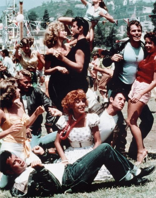 Grease:  John Travolta and Olivia Newton-John.  Music and mayhem in the 50's